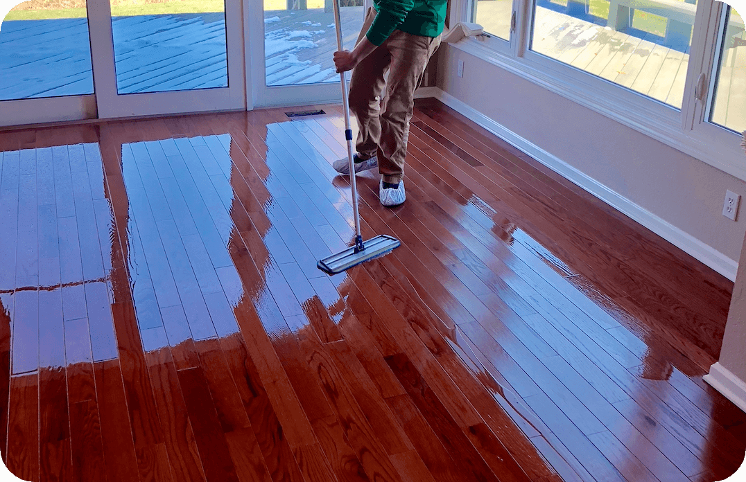 Restoring Hardwood Floor and applying 1-2 year Semi-Gloss Finish (brings out the wood grain)